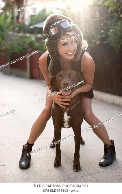 Caucasian woman in fur hat riding dog