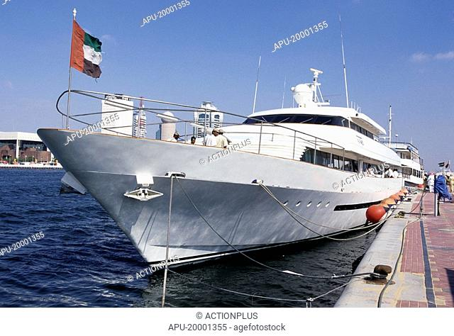 Large ocean yacht anchored by dockside