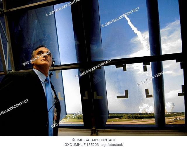 NASA Associate Administrator Rex Geveden watches the launch of the Space Shuttle Atlantis (STS-117) from the Launch Control Center at the Kennedy Space Center...