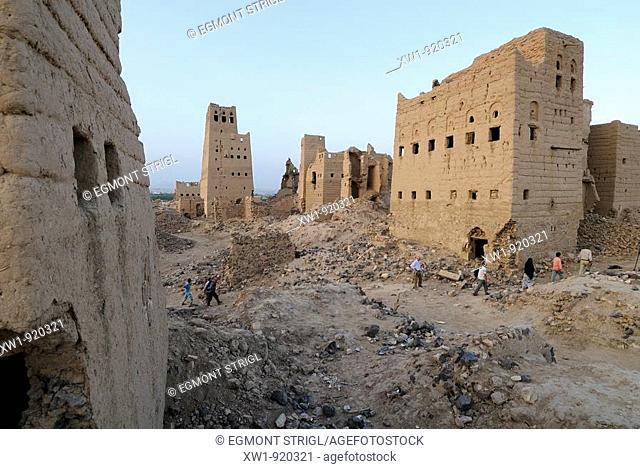 group of tourists hiking through the ruins of old Marib, Yemen, Arabia, West Asia