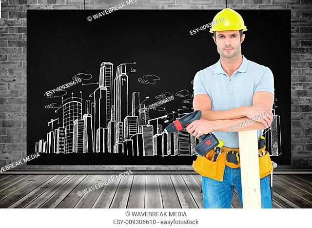 Composite image of confident carpenter with wooden plank and drill machine