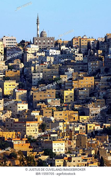 Mosque and houses in Amman, Jordan's capital, at sunset, Hashemite Kingdom of Jordan, Middle East, Asia