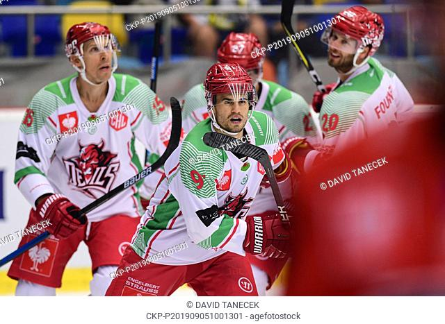 From left hockey player BRYCE REDDICK of Carrdif (centre) celebrates a goal during the Champions Hockey League H group game: Hradec Kralove vs Cardiff Devils in...