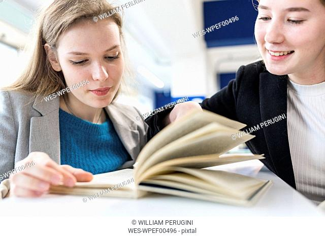 Portrait of teenage girls in a public library
