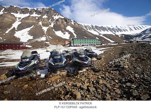 Snowmobiles / snowmachines in the town Longyearbyen in spring, Svalbard / Spitsbergen