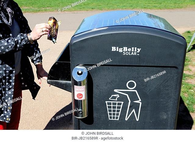 Solar powered waste bin which periodically compresses its contents so it does not need emptying so frequently