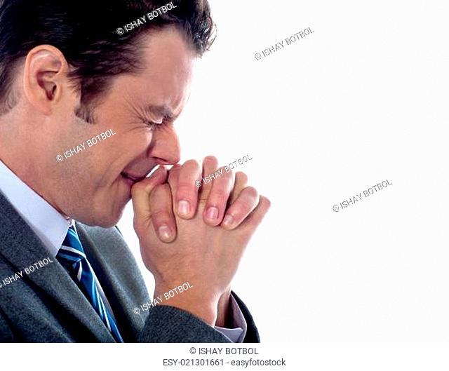 Business executive praying to god