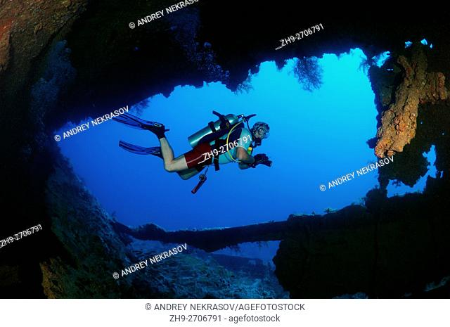 Male scuba diver inside the wreck of the SS Dunraven, Red Sea, Egypt