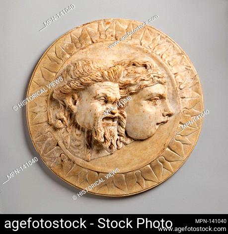 Marble disk with two theater masks in relief. Period: Early Imperial; Date: 3rd quarter of 1st century A.D; Culture: Roman; Medium: Marble; Dimensions: Diam