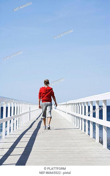 A man walking on a jetty Malmo Skane Sweden