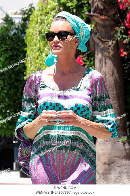 Janice Dickinson poses in a silk Hale Bob dress and headscarf while out and about in Beverly Hills Featuring: Janice Dickinson Where: Beverly Hills, California