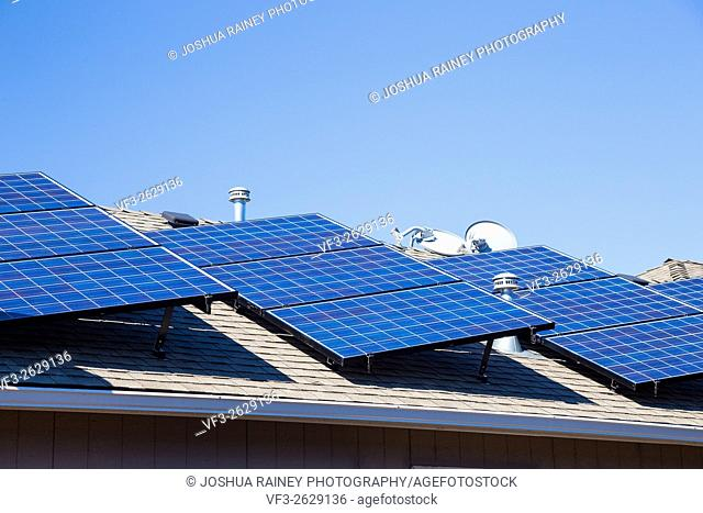 Sustainable energy from the sun goes into these solar panels on top of a house in Oregon