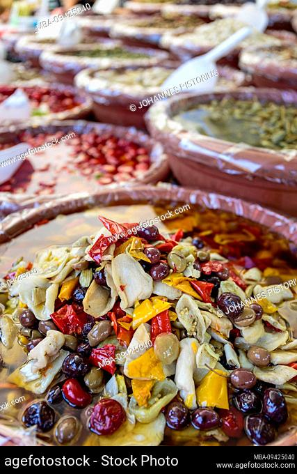 Europe, Italy, Piedmont, Cannobio. Jugs with antipasti at the stall of a trader at the weekly market