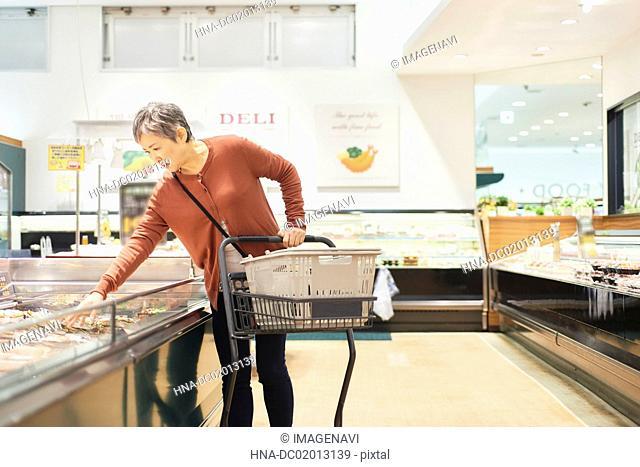 Senior woman shopping in supermarket
