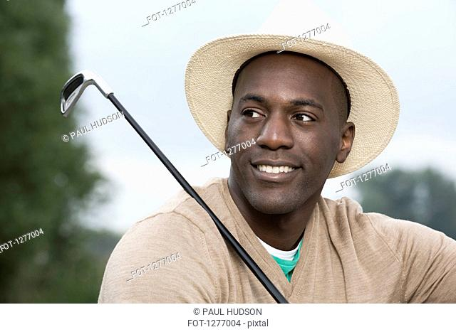 Man relaxing at the golf course