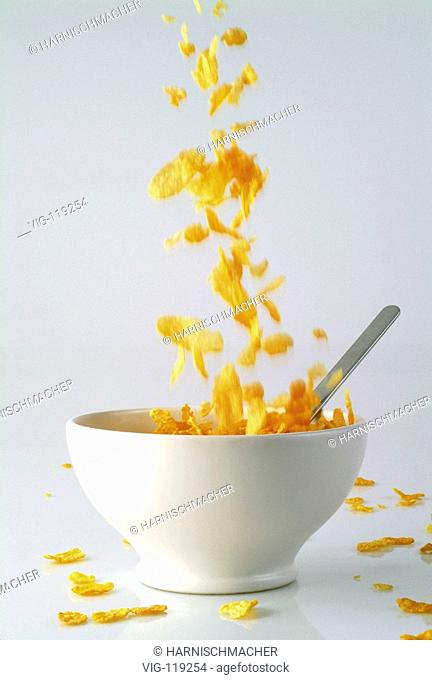 Cornflakes falling into a cup.  - 27/10/2005