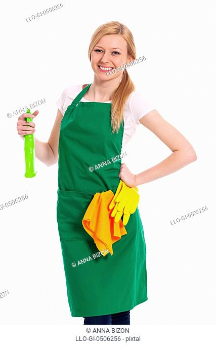 Cheerful cleaner with liquid and protective glove, Debica, Poland