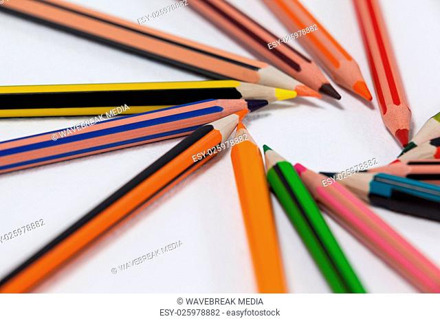 Close-up of colored pencils arranged in a circle