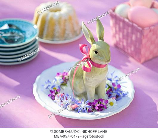 Porcelain rabbit in the wreath of flowers