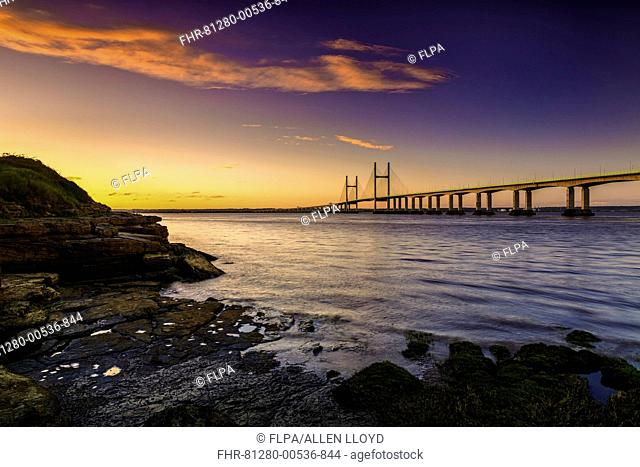 View of road bridge over river at sunrise, viewed from Diver's Rock at Sudbrook, Second Severn Crossing, River Severn, Severn Estuary, Monmouthshire, Wales, May