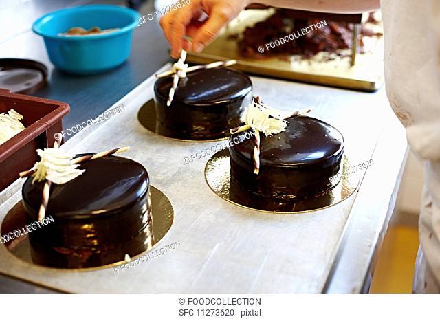 Festive cakes with a dark chocolate glaze
