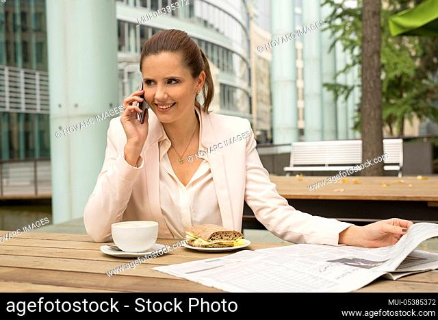 Young businesswoman sitting in a cafe