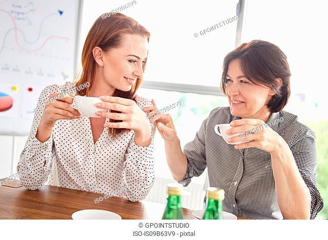 Women having coffee break together