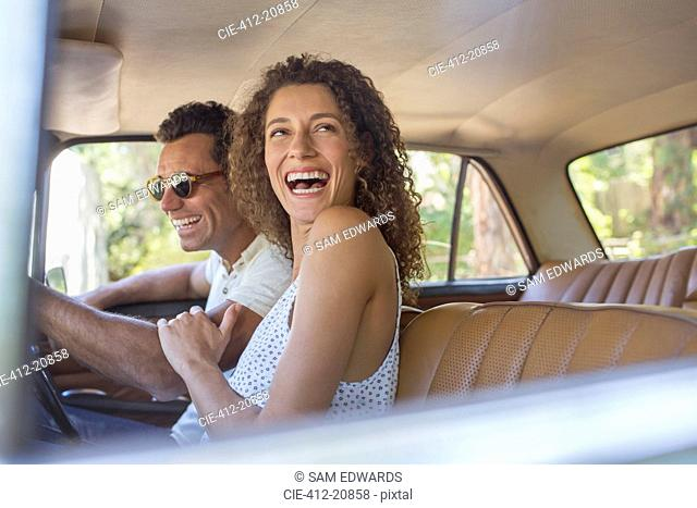Couple laughing during car ride