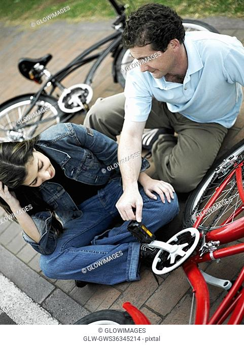 High angle view of a mid adult couple sitting with bicycles