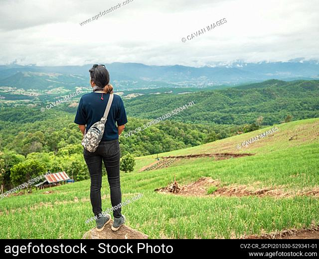 Woman at nice mountain range and valley view