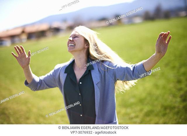Waakirchen, Bavaria, Germany, lively woman on meadow