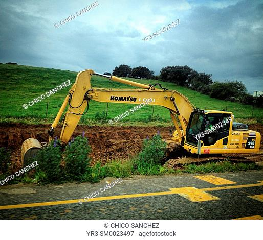 A bulldozer excavator destroys the land to build a road in Plasencia, Caceres, Extremadura, Spain