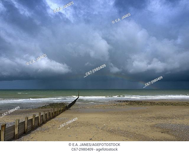 Stormy weather and rainbow at Cromer North sea North Norfolk in Autumn