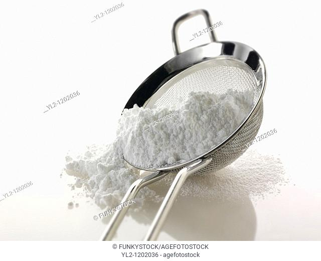 Icing sugar on a sieve