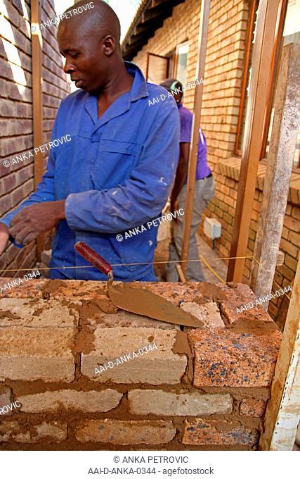 Brick layers laying bricks, Moreleta Park, Pretoria, Gauteng Province, South Africa