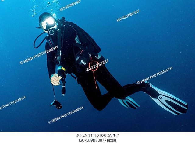 Scuba diver off coast, Tulamben, Bali, Indonesia