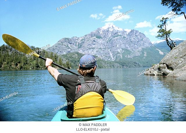 Portrait of a Man in a Kayak with the Mountains in the Background  Lake Patagonia, Moreno West, Bariloche, Lake District, Argentina, South America