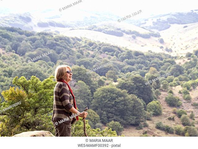 Italy, Sicily, Castelbuono, Parco delle Madonie, senior woman hiking