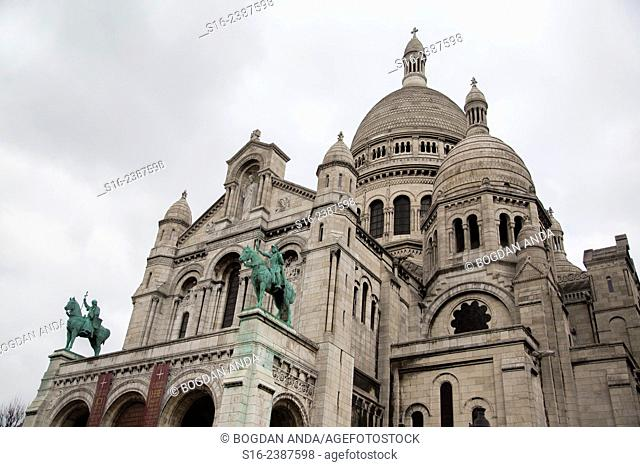 Paris, Montmartre, France - Facade of the Sacre-Coeur Basilica with its green copper statues
