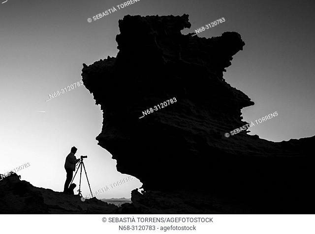 Rock and photographer shape at Formentera, Balearic Islands, Spain