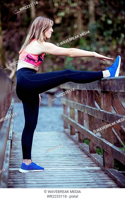 Pretty blonde woman stretching her legs