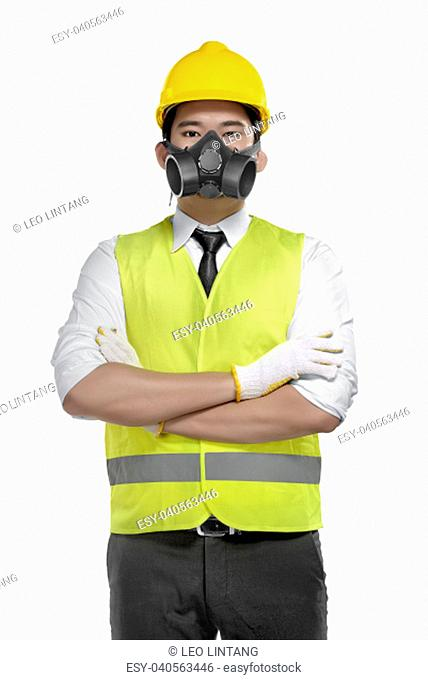 Portrait of asian foreman with yellow helmet posing isolated over white background