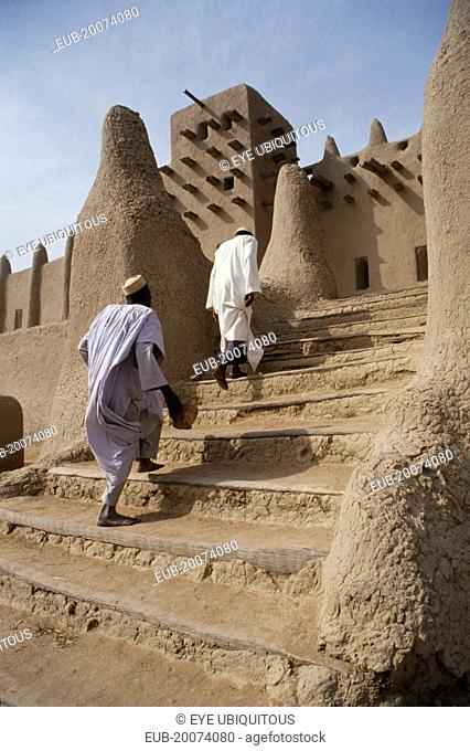 Two men walking up steps leading to Grand Mosque