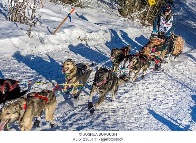 Jeff King and team run down the trail on Long Lake shortly after leaving the re-start in Willow, Alaska during the 2016 Iditarod