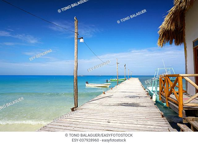 Holbox tropical Island wooden pier in Quintana Roo of Mexico