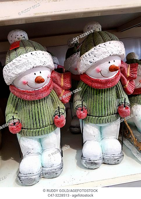 Smily dolls on winter outfit. Christmas time. Barcelona. Spain