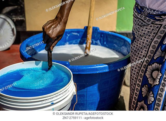 A housewife prepares liquid soap for selling in the market in Visiga Kwa Kipofu near Dar Es Salaam, Tanzania