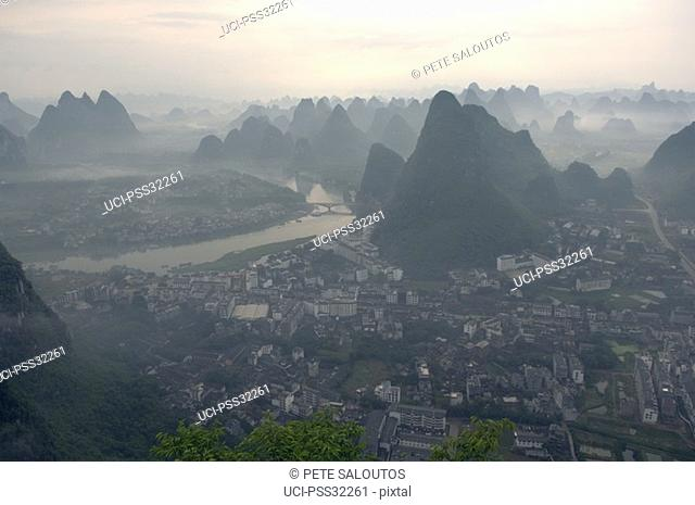 Scenic view of town and mountains, Guilin, China