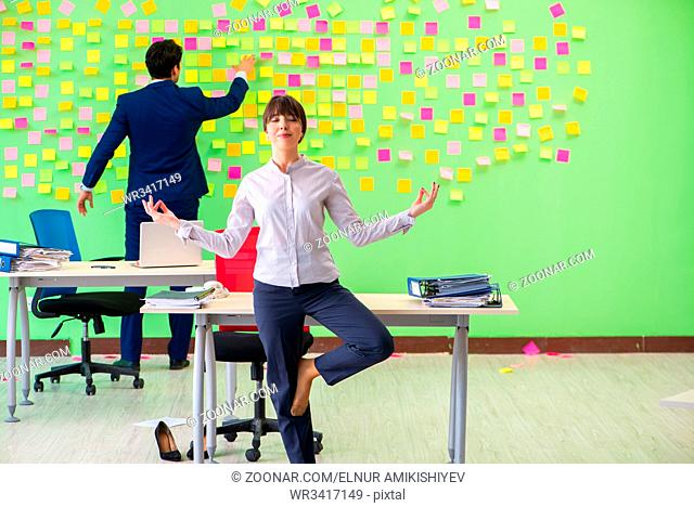 Man and woman in the office with many conflicting priorities in yoga concept