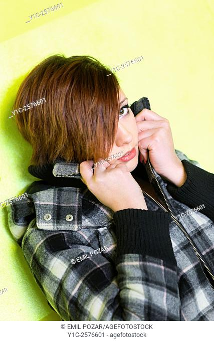 Teen girl is afraid hiding face